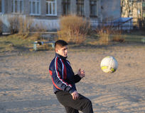 Teenager playing soccer Stock Photography
