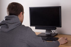 Teenager playing a video game Stock Photography