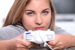 Teenager playing video games. Female teenager at home playing video games Stock Images