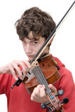 Teenager playing violin. Isolated on pure white Royalty Free Stock Photography