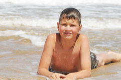 Teenager  playing in the waves Royalty Free Stock Photos