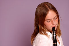 Teenager plays clarinet Royalty Free Stock Images
