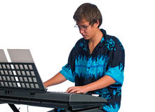 Teenager plays classical music on a keyboard Stock Photos