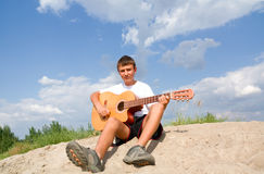 A teenager plays on a guitar Royalty Free Stock Photo