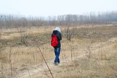 A teenager was hiking in the Yellow River bank royalty free stock image