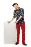 Teenager pointing at blank poster Royalty Free Stock Images