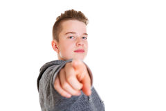 Teenager pointing in to the camera Stock Images