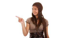 Teenager pointing to the copyspace. Young beautiful teenager pointing to the copyspace (isolated on white Royalty Free Stock Photos