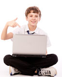 Teenager pointing to the laptop. On white background Stock Image