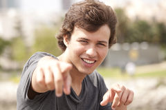 Teenager pointing to you. Handsome teenager pointing to you Stock Photos