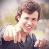 Teenager pointing to you. Handsome teenager pointing to you Royalty Free Stock Photo