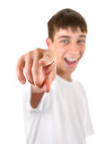 Teenager Pointing at You. Cheerful Teenager Pointing at You. Focus on the Fingers Stock Images