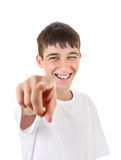 Teenager Pointing at You. Cheerful Teenager Pointing at You. Isolated On The White Background Royalty Free Stock Image