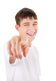 Teenager pointing at You. Cheerful Teenager Pointing at You on the White Background Stock Image