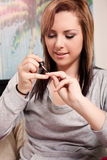 Teenager polishing her nails Royalty Free Stock Images