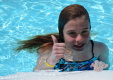 Teenager in pool Stock Images