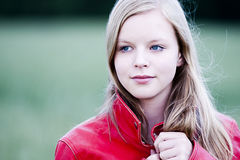 Teenager Portrait. In nature with a red leather jacket stock image