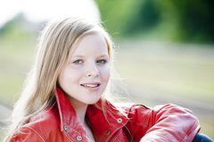 Teenager Portrait. In nature with a red leather jacket stock photo