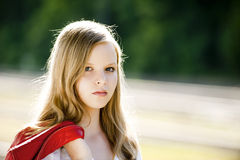 Teenager Portrait. In nature with a red leather jacket royalty free stock photos