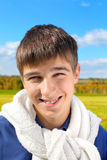 Teenager portrait. Happy and smiling teenager portrait in the autumn field Stock Photo