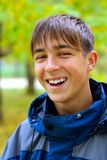 Teenager portrait. In the autumn park Royalty Free Stock Images