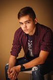 Teenager. Portrait of young handsome teenager boy in checkered shirt Royalty Free Stock Photo