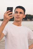Teenager posing and taking a selfie. Close-up Photo Stock Images