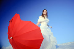 Teenager posing in white wedding dress Stock Images