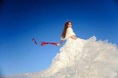Teenager posing in white wedding dress Royalty Free Stock Image