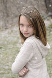 Teenager posing in winter. White beautiful girl relaxing in winter season, snowing and flakes around Stock Image