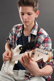 Teenager practicing electric guitar Stock Photo