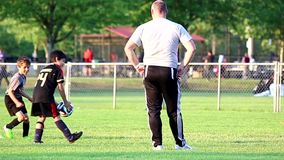 Teenager practicing football skill stock video