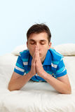 Teenager praying Stock Photos