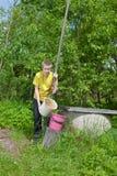 The teenager prepares water Stock Image