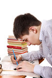 Teenager preparing for Exam. Student preparing for Exam at the School Desk Stock Photography
