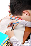Teenager preparing for Exam. Student preparing for Exam at the School Desk Stock Photo