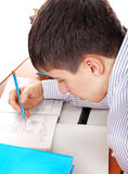 Teenager preparing for Exam. Student preparing for Exam at the School Desk Royalty Free Stock Images