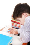 Teenager preparing for Exam. Student preparing for Exam at the School Desk Royalty Free Stock Photography