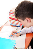 Teenager preparing for Exam. Student preparing for Exam at the School Desk Royalty Free Stock Image