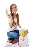 Teenager with presents. Pretty teenager with giftboxes thinking what present to give for birthday Stock Photo