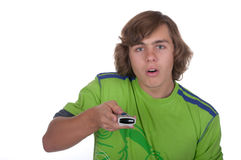 Teenager presses control panel buttons. On a white background Royalty Free Stock Images