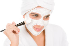 Teenager problem skin care - woman facial mask Stock Photography