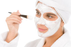 Teenager problem skin care - woman facial mask. Apply with brush Royalty Free Stock Image