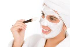 Teenager problem skin care - woman facial mask. Apply with brush Stock Photos