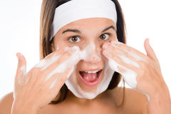 Teenager problem skin care - woman wash face Royalty Free Stock Image