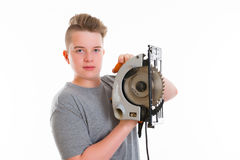Teenager in professional training using  circular hand saw. Teenager in professional training using circular hand saw  in front of white background Stock Image