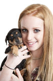 Teenager with puppy Royalty Free Stock Photos