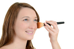 Teenager putting on blush Stock Image