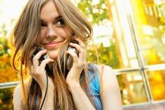 Teenager putting on headphones Stock Photos