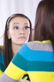 Teenager Putting on Make Up Royalty Free Stock Images